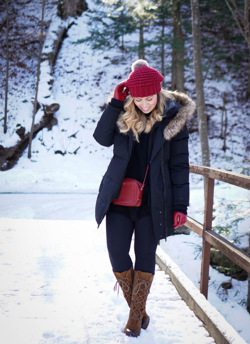 Bundled Up in the Snow Black & Red Winter Snow Outfit | Noize Down Parka Sorel Cate the Great Lace Up Boots Black Leggings
